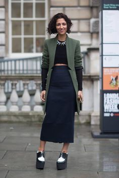 20 Ways to Pull Off Platforms This Spring - hunter green blazer with notched lapel  detail, back crop top, midi-length pencil skirt, + black and white platform oxfords