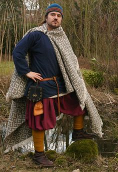 Pathgalen on deviantART, showing the Oseberg style of woven and fringed cloak that was for sale a few years ago.