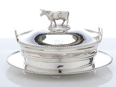 English antique silver covered butter dish. Cow handle butter dish on tray Dimensions: 4½″ tall Age: 1880
