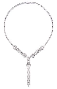 18 KARAT WHITE GOLD AND DIAMOND NECKLACE, CARTIER Of geometric design, set with round diamonds weighing approximately 7.95 carats, length 16 inches, signed Cartier, numbered 53810C, with maker's mark; pendant detachable. With signed pouch.