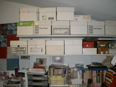 All the large boxes are full of finished crafts: Crocheted baby and adult hats, knitted and crocheted booties and slippers, many different sized tote bags, scarfs, crocheted toys, baby quilts, lap quilts and more. Smaller boxes are pictures waiting to go into scrap books. Below from left to right: Bowling trophies, how to magazines and books, cross stitch floss, crafting notions,  more books and magazines.