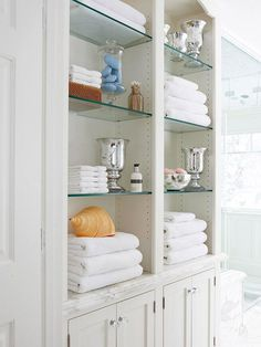 SHELVING Make a small bath look larger: Glass Shelves. Glass shelves increase a room's sense of space because they can appear invisible. Items placed on them seem to hover in air -- a much lighter effect than heavy cabinetry. Glass Bathroom, Bathroom Shelves, Bathroom Storage, Bathroom Cabinets, White Bathroom, Bathroom Closet, Bathroom Kids, Kitchen Cabinets, Master Bathroom