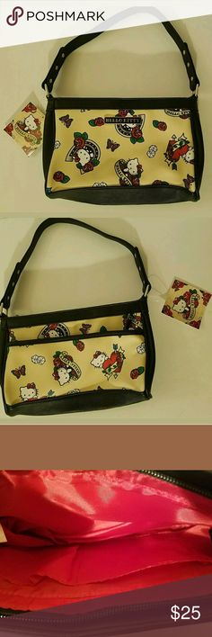 Hello Kitty NWT Small Heart Horseshoe Purse This adorable purse is brand new from the Sanrio store.   Perfect accessory for an outfit.   Add to a bundle and save. Sanrio Bags