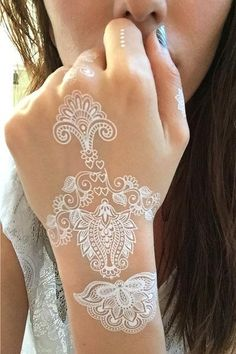 White tats are the newest trend in temporary tattoos. They are great for the summer and are suitable for ALL skin tones. Each set contains 2 sheets with several designs to be used together or separate