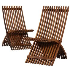 Pair of Danish Folding Mahogany Garden Chairs   From a unique collection of antique and modern garden furniture at http://www.1stdibs.com/furniture/building-garden/garden-furniture/