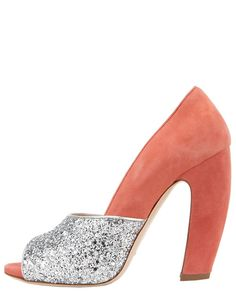 mui mui...not sure why I like these, I don't much care for glitter or the type heel that curves out, but I like these.