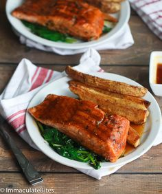 Jamaican Jerk Salmon- Spicy Glazed salmon with tons of flavor , paired with crispy Jerk Potatoes and Wilted Spinach. A complete meal that would excite your tastebuds- It's quick, it's easy and it's Luscious. Jamaican Dishes, Jamaican Recipes, Salmon Recipes, Seafood Recipes, Oven Recipes, Cooking Recipes, Barbados, New Zealand Food And Drink, Jerk Salmon