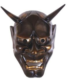 Decorative metal mask of Noh theatre character Hannya. The mask represents a female serpent-demon filled with malicious jealousy and hatred. From 1970's