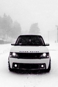 White range rover with big shiny rims and the darkest tinting legally allowed for the windows, my dream car <3