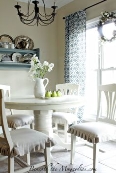 Love the round white table and chairs topped with white pitcher, white irises and pears...very serene...beautiful  http://www.homestoriesatoz.com/2012/03/renovation-restoration-tutes-tips-not-miss.html#