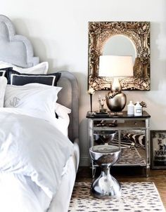Love the headboard & mirrored furniture...very glam!! (via interiordecline)