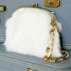 Learn how to work with fur and purse frames in this tutorial for an elegant handbag.