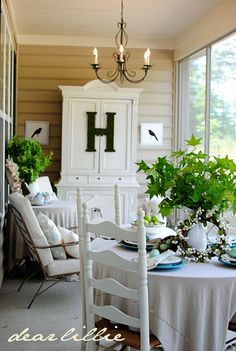 Color on the Porch Part II (The Blue Armoire) by Dear Lillie - love the blue armoire & the blue plates & eggs