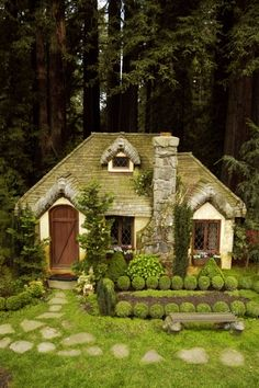 a green cottage. if the windows were round it would remind me of a Hobbit House!!
