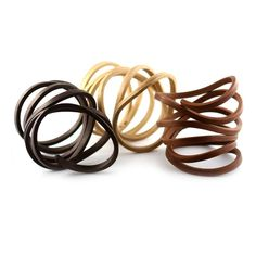 Organic coil bracelets by Gustav Reyes, reclaimed woods like hickory, cherry and walnut. Gallery Lulo.