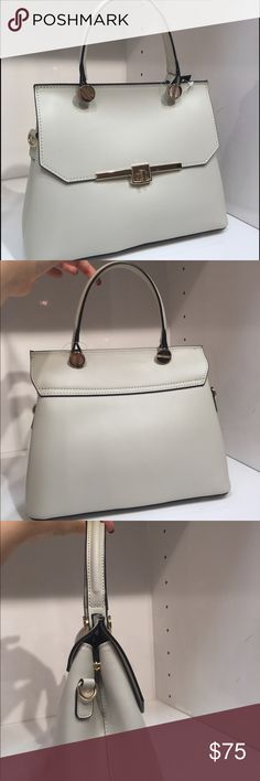 GORGEOUS bone color Italian leather handbag Gorgeous bone colored made in Italy Italian leather handbag. This is a showroom handbag sample so it has never been used. It has a long cross body strap for versatility. Don't hesitate! She's a beauty! Bags Satchels