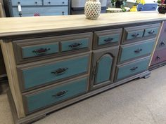 The old buffet that you see everywhere updated with pewter and teal chalk paint is now a great new dresser or TV stand. Even the old hardware is fantastic painted with dark nickel.
