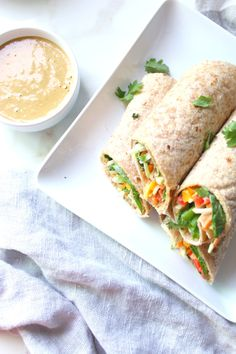 TheseVeggie Thai Wraps with Spicy Peanut Sauce make a simple and delicious lunch, snack or dinner. Perfect for back to school!   ThisSavoryVegan.com