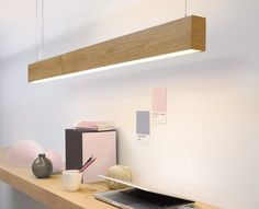 Beacon Lighting - LEDlux Nord Rectangle up/down LED pendant in teak A nice idea for the office lighting, a less expensive version but underneath the overheads. Office Lighting, Kitchen Lighting, Home Lighting, Modern Lighting, Lighting Design, Lighting Ideas, Modern Lamps, Wood Pendant Light, Modern Pendant Light