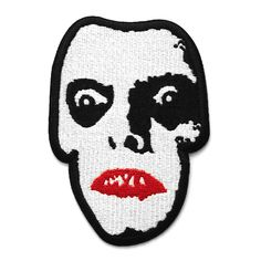 """Embroidered patch. 4"""" tall. Iron-on backing."""