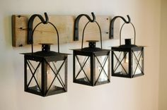 Black Lantern Trio Wall Decor, Home Decor, Rustic Decor, hanging from wrought iron hooks on wood board by PineknobsAndCrickets on Etsy https://www.etsy.com/listing/162620569/black-lantern-trio-wall-decor-home-decor
