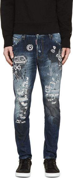 Slim-fit jeans in deep blue. Fading and heavy distressing throughout. Paint splatters throughout in black. Text and graphic prints throughout in white. Five-pocket styling. Contrast stitching in tan. Button fly.