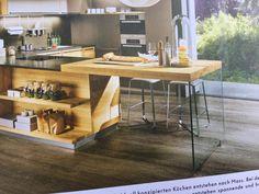 Jako ostruvek v kuchyni mit dreveny stul jako na obrazku, pouze ale s melkymi skrinkami ze strany od kuchynske linky.