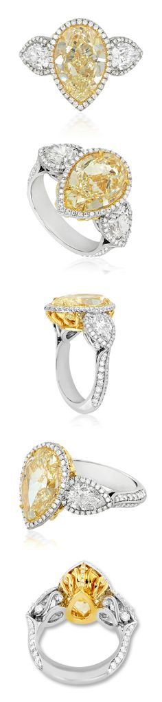 A stunning blend of artistry and craftsmanship, this exquisitely designed platinum/18K gold ring features a 5.61 carat SI1 pear shaped Fancy Yellow diamond set in 18K yellow gold to accentuate its color. The gallery in the center is gilded in yellow gold, enhanced by decorative flourishes encrusted with Fancy Yellow diamonds. LBV