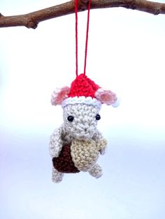 This Christmas mouse ornament would be a great addition to your Christmas decorations. He will bring Christmas spirit to your home. This cute mouse wears a red Santa hat and is holding a little acorn. Hes crocheted using a 100% cotton yarn. He will make your Christmas home decoration more cheerful and attractive. It Would be a perfect little Christmas gift for people who love handmade creations. It would also be a wonderful addition to your Holiday decor. This little mouse measures 9 cm (3,5…