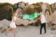 Marriage Proposal Ideas from HowHeAsked Paint Fight Engagement Photos