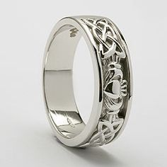Google Image Result for http://www.celtic-weddingrings.com/files/images/759-Claddagh-Trinity-Inset-Ring-Yellow.jpg