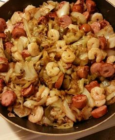 Fried cabbage with sausage & shrimp I start buy frying in bacon grease, let my cabbage cook down add bell pepper, onion & seasoning of your choice. I saute sausage and shrimp in a separate pan and then mixed together! Easy peasy!! 😃😋