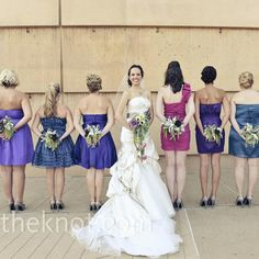 Jamie simply asked her eight bridesmaids to buy short party dresses in jewel tones. It just naturally worked out that they had two girls in each of four colors.
