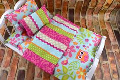 This colorful Owl adorned pattern has so many options. Lively and colorful owls with a coordinating striking pattern on the reverse side. Mattress is gently hand stuffed and is adorned in vibrant owls