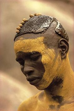 Africa | A Nuba from Kau with his painted face mask.  Sudan.  Featured in the 1976 publication: People of Kau. | © Leni Riefenstahl.
