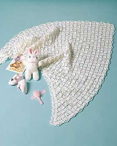 This beautiful lacy Baby Shawl would be heirloom-quality gift for the new arrival!