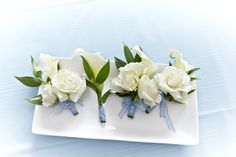 Classic white rose boutonnieres with blue ribbon wrap. Photography by @Scott Faber