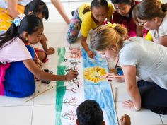 Julia is painting with her students. #vpbali #creativelearning #arts