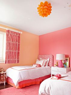 With bold color-blocked walls in shades of pink and peach, the linens on the pair of beds remain white. The window treatments and bed skirts combine this fun and feminine color palette in beautiful and very different ways. Bedroom Wall Designs, Bedroom Wall Colors, Paint Colors For Living Room, Bedroom Decor, Orange Rooms, Bedroom Orange, Bedroom Color Combination, Happy Room, Bright Rooms