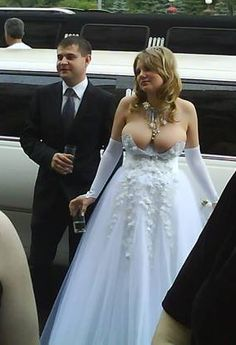 Hmmmmm.... I think the symbolism of the virginal white wedding gown was lost on this blushing (busting out) bride.