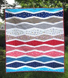 New Wave quilt by Michelle Engel - - looks similar to a Tumbler Quilt, just that the tumbler is longer/skinnier.