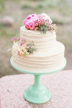 A sweet, petite buttercream #cake displayed on a mint milk glass stand. {Candice Benjamin Photography}