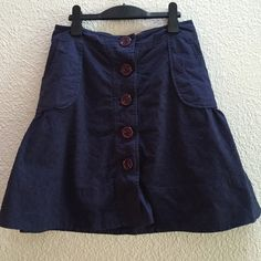 """Anthro Odille navy blue eyelet skirt Anthropologie button front a-line skirt from Odille. 100% cotton in navy blue eyelet material with purple buttons. 14.5"""" across front while laying flat. 19.5"""" in length. Excellent used condition. I love this but it's just a wee bit too snug. Anthropologie Skirts"""