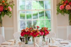 Peonies and  ranunculus and other spring garden flowers are featured in these wedding reception centerpieces. Flowers grown and designed by Floret    Photo by Joann Arruda