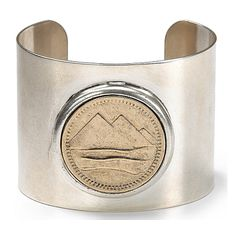 """Coin Cuff from Low Luv by Erin Wasson - Low Luv by Erin Wasson captures the rustic Americana look like no other. This vintage-inspired cuff looks like a souvenir from an epic cross-country roadtrip.Silver/14K gold plated metal. Imported.2.25"""" diameter. $189"""