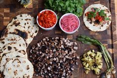 """Tacos al pastor translates to """"tacos in the style of the shepherd."""" The spit-roasted pork found its way to Mexico via Lebanese immigrants and their shawarm Okonomiyaki Recipe, Brooklyn Kitchen, How To Make Taco, Stuffed Mushrooms, Stuffed Peppers, Taco Tuesday, Pork Belly, Pork Roast, Grilling Recipes"""