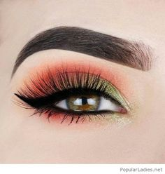 Orange eye makeup with green detail