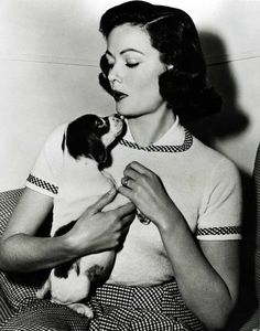 Gene Tierney and a preciously sweet little pup.