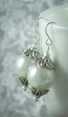 Ivory Pearl Drop Earrings with Silver by ButterflyJade on Etsy https://www.etsy.com/listing/223631906/ivory-pearl-drop-earrings-with-silver
