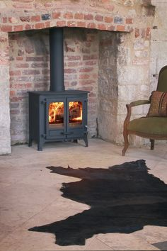 Charnwood Island 2 multi fuel & wood burning stove has double doors, various colours and convection panel options. Defra Approved for use in smoke control areas. My Living Room, Living Spaces, Modern Stoves, Stoves For Sale, Wood Fuel, Multi Fuel Stove, Island 2, Log Burner, Living Room Inspiration